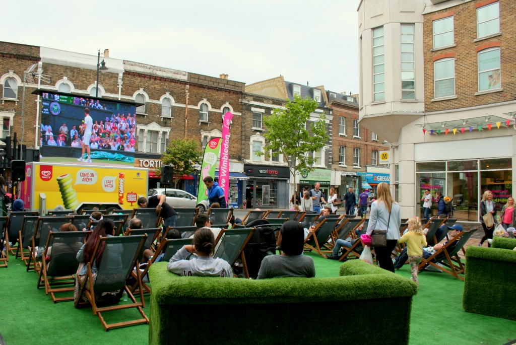 The giant screen is uncovered near the railway station as the town follows the game.